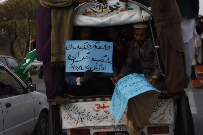 A pickup van with TuQ Supporters