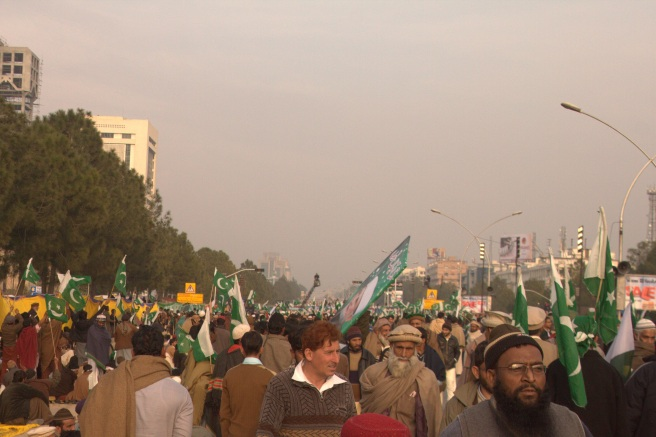 People walking near Saudi Pak Tower